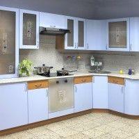 угловая голубая кухня с радиусным фасадом