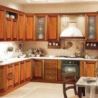 угловая кухня в классическом стиле с радиусными фасадами